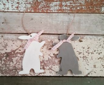 A Pair of Hand Painted  Hanging Wooden Paws Up Bunnies