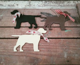 A Trio of Large Painted Hanging Labrador Decorations