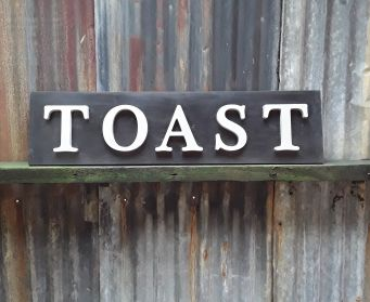 Black And Grey Painted Wooden TOAST Sign